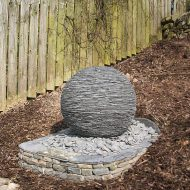 Slate sphere built on dry stone base