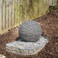Slate sphere built on dry stone base