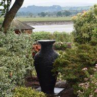 Slate garden vase sculpture