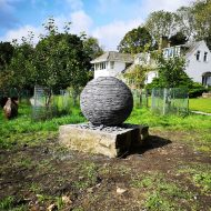 Slate sphere sculpture